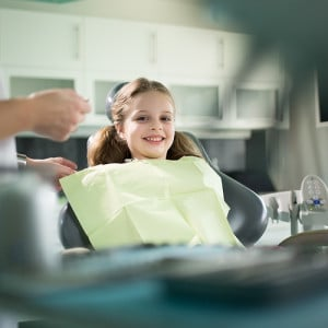 happy-kid-at-pediatric-dentist