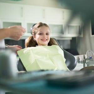 happy-kid-at-pediatric-dentist